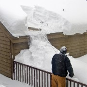 Too much snow on your roof? Why a pro should always shovel it