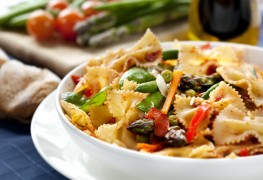Nosh on bowtie pasta with beans and greens