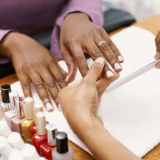 Pamper your hands with a manicure at a nail salon
