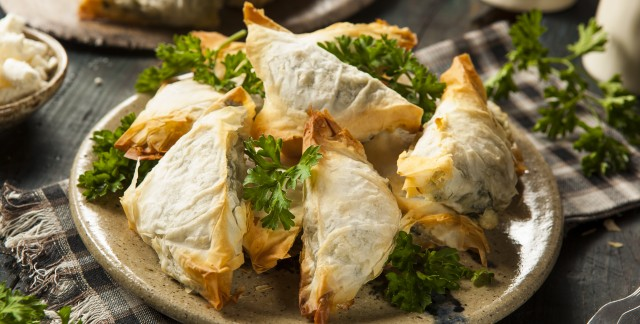 Homemade spinach and feta-stuffed phyllo pastries