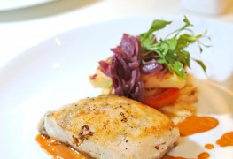 Seared fish steaks with tomato-olive sauce