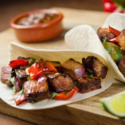 A quick recipe for flank steak fajitas with peppers and onions