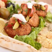 A simple recipe for braised vegetables with falafel and yogurt sauce