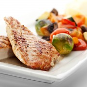 Zesty Mexican-style corn and pepper relish on grilled chicken