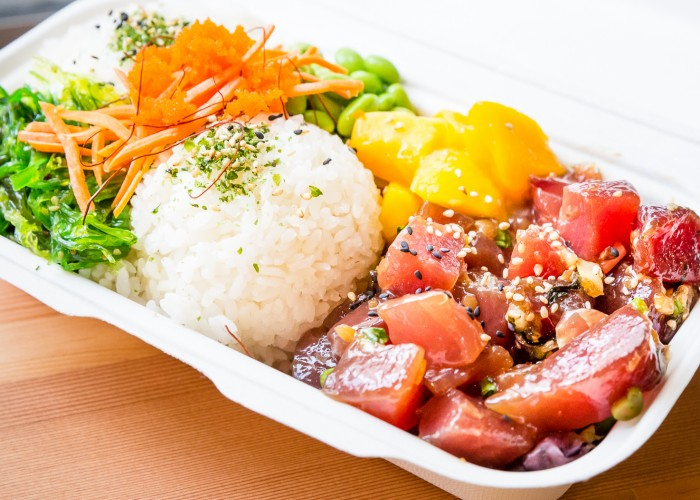Poke is traditionally made with raw albacore or ahi tuna. The Poke Guy also offers cooked scallops and shrimp for those who are squeamish about raw fish, and tofu for vegetarians.