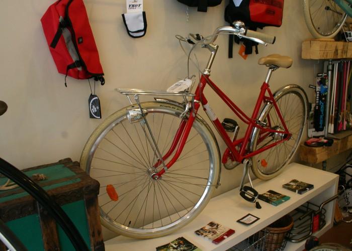 Bikes, bike accessories, cafe, family cargo bike rentals, bike repair, wheel truing, gear and brake adjustment, winter storage, tune-up, bike build.