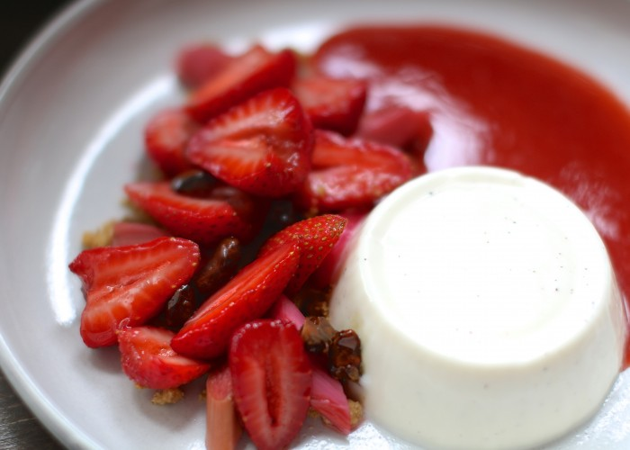 Angolino's vanilla-kissed panna cotta served with strawberries and candied pistachios.