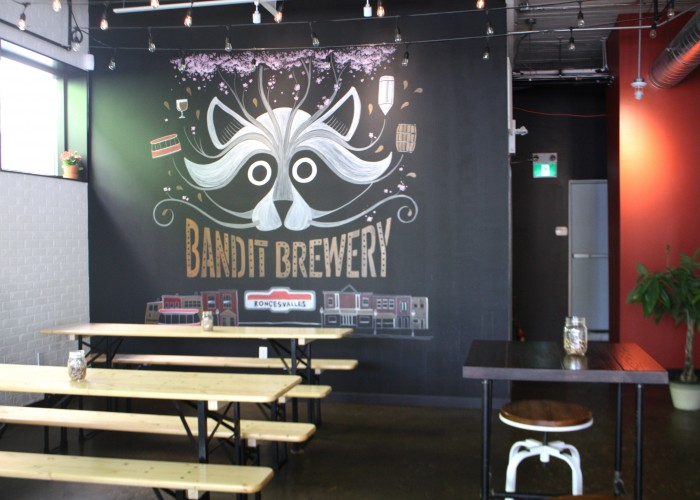 Bandit Brewery evokes the feeling of a German beerhall with communal picnic tables and ethereal lights strung across the ceiling.