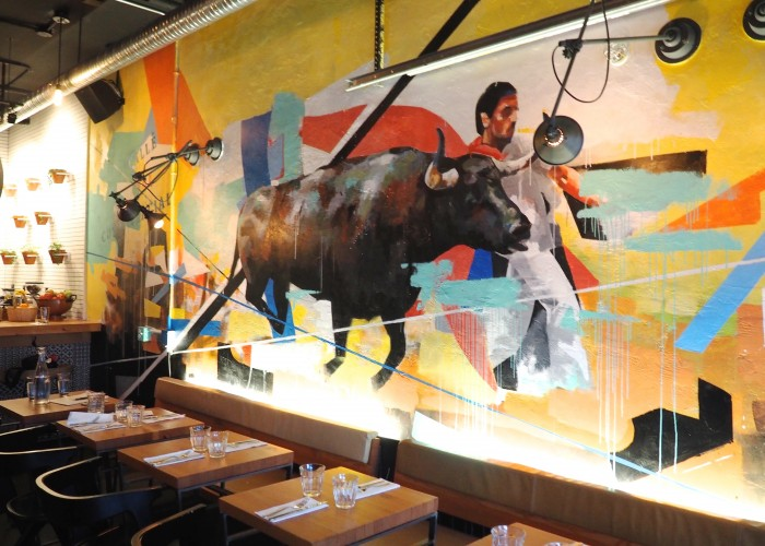 A colourful mural by artist Yared Nigussu is a focal point of the dining room at Cabrito.