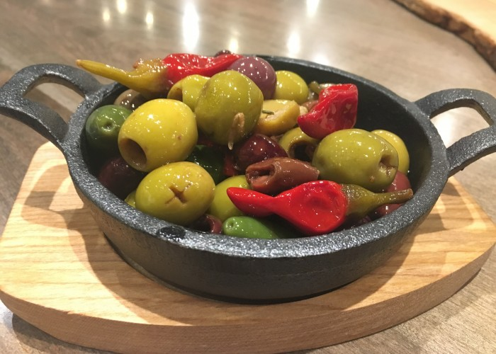 Capra's Kitchen serves an enticing plate of olives.