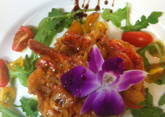 André Loiseau, owner of Carte Blanche, works with edible flowers to add colour to his dishes.