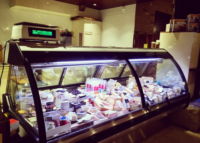 Cavern carries a selection of international artisanal cheeses, wine and espresso.