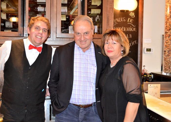 Chez Lévêque owners Peter and Patricia Lévêque, with the restaurant's maître d' Yann Nkanko.