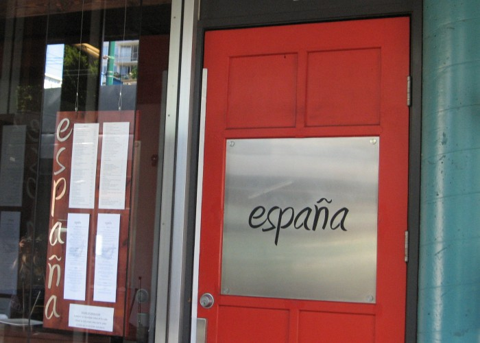 A red door opens to España: a taste of Spain on Denman Street.