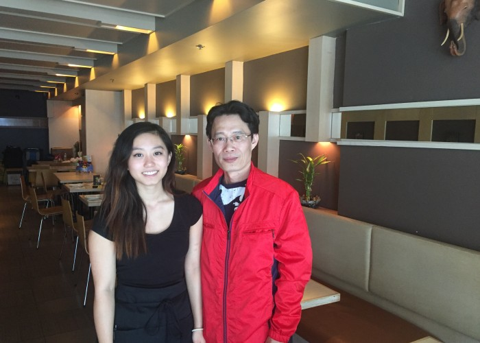 Green Papaya owner poses with his daughter in the restaurant dining room.