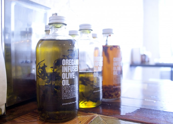 House-made olive oil adorns each table at Pizzeria Farina