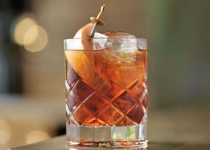 Indulge in a classic Negroni at the bar of L'Abattoir.