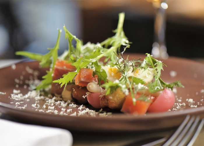 Steelhead Trout with Crunchy Potato Salad is among the many exquisite, yet casual, plates by chef Lee Cooper.