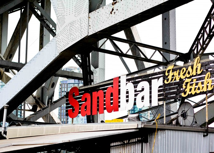 The Sandbar is nestled is a picturesque location under the Granville Street Bridge.
