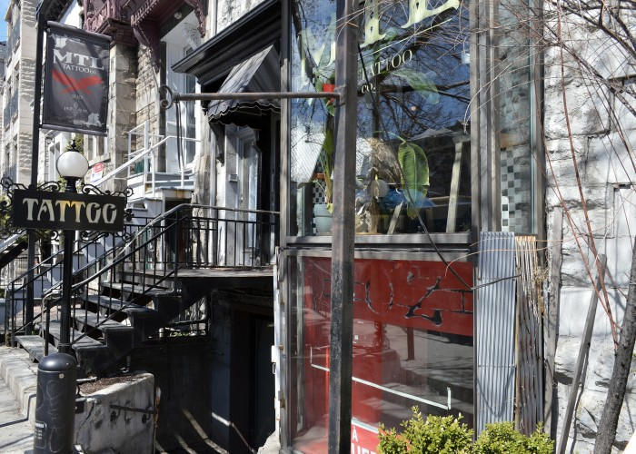 The exterior of MTL Tattoo, a tattoo shop that offers unique, customized tattoos — neo-trad styles, realistic, Japanese, graphic, dotwork — as well as piercing.