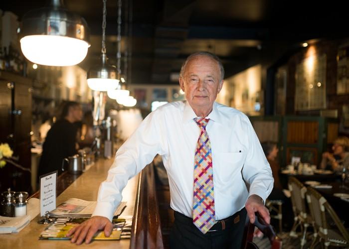 Merlot owner Francois Duprix poses in his restaurant