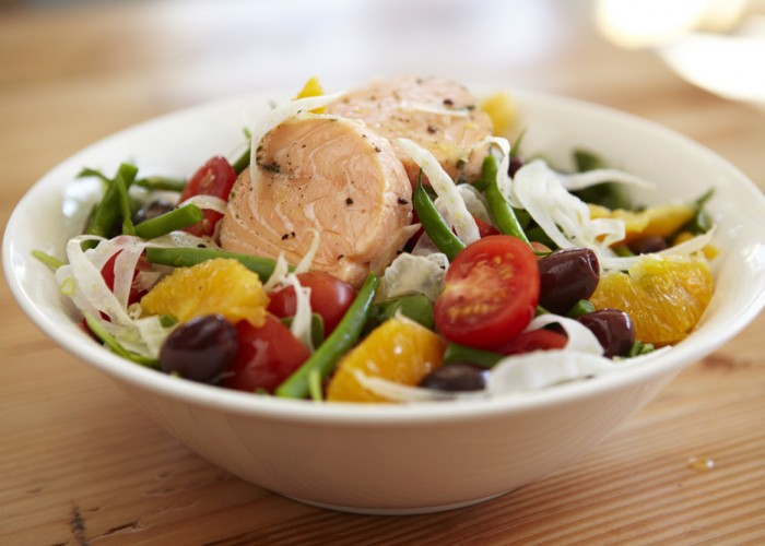 The signature salmon salad is served with field greens, tomatoes, fennel, asparagus, oranges, olives and a house-made citrus vinaigrette.