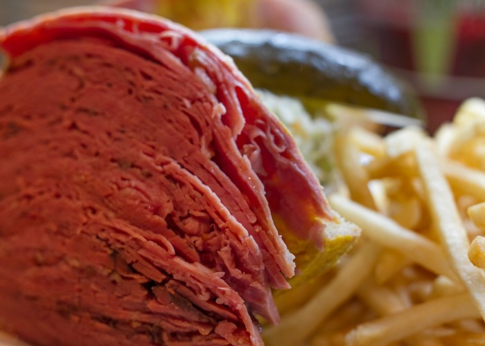 Reuben's Deli & Steakhouse became an iconic part of the city by serving Montreal-style smoked meat sandwiches.