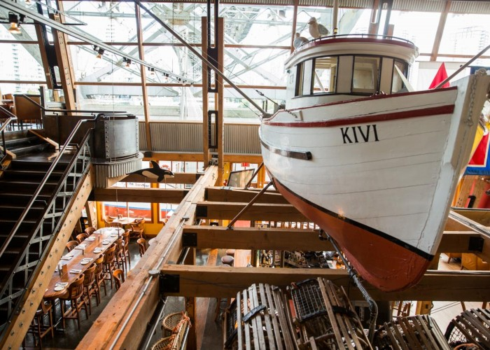 A 24-foot salmon troller hand built by Vancouver craftsman Allan Farrell hangs in the restaurant's nautical inspired interior.