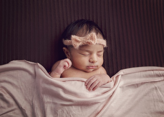 Kara Jensen Photography works with clients to create a unique newborn photography concept