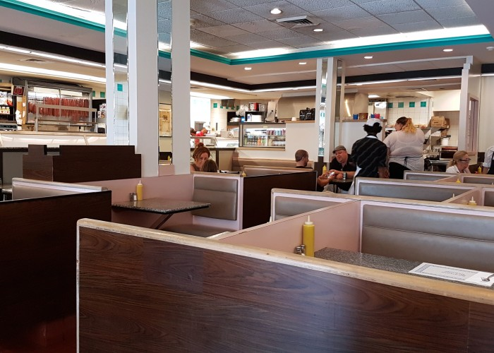 The upright beams in the middle of the Snowdon Deli were part of the original dividing wall between the deli and a pharmacy.