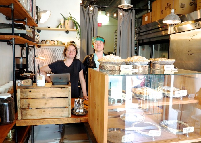 Pie bakers Stephanie and Andrea French behind the counter at their pint-sized specialty bakery.