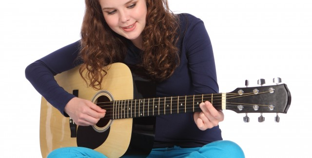 Tips for mastering finger picking on an acoustic guitar