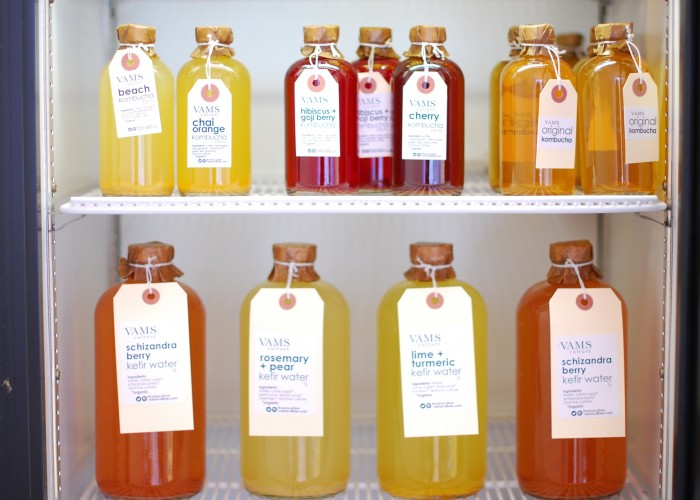 The fridge, fiilled with made-in-house kombucha, is a welcome sight on hot summer days.
