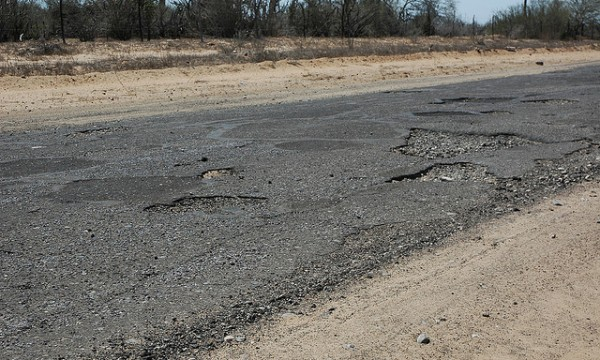Vehicle insurance reimbursement and damaged roads