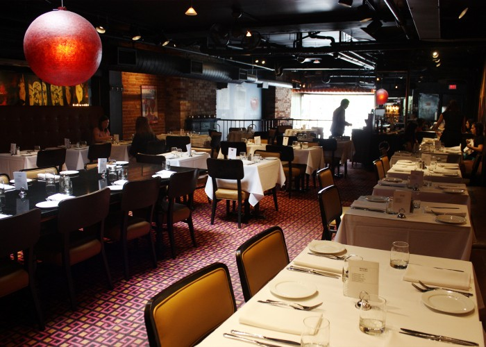 The rich menu and cool spacious ambiance with swank art on red brick walls, open kitchen, and friendly service also make Fred's Not Here a desirable pit stop for downtown diners.