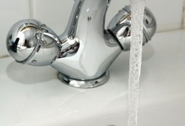 Why is hot water coming out of the cold side of the tap?