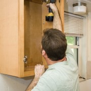 How are kitchen cabinets manufactured?