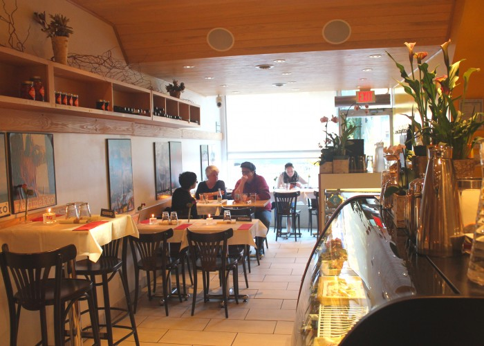Inside, the narrow restaurant feels cozy with cheery yellow accents and plenty of vintage Marimekko posters.