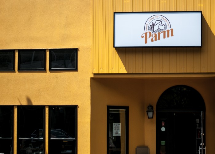 Parm's exterior on First Street is a bright, welcoming yellow.