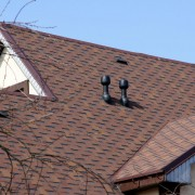 Should I install a flat or sloped roof?