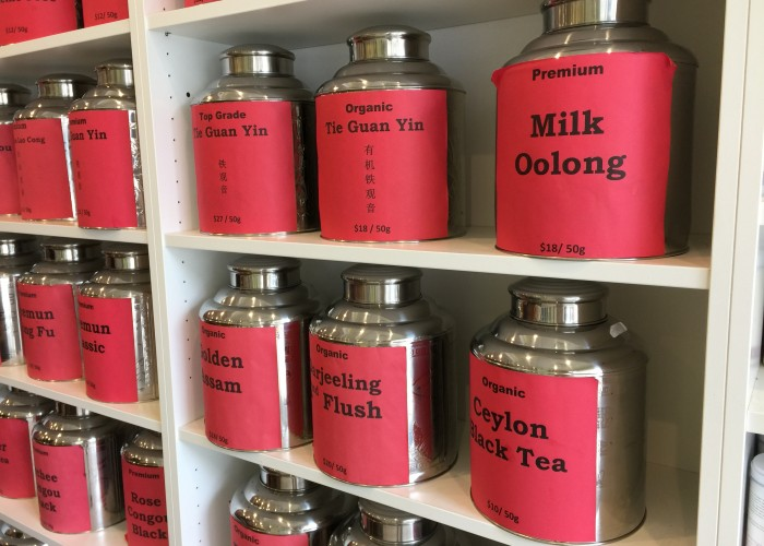 Tao schools clients on the differences between unique types, such as white tea, oolong, and pu'erh.