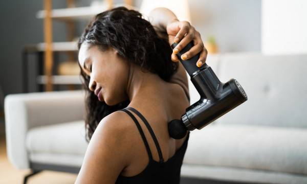 How to use a massage gun on sore muscles